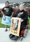 Members from the activist group 'Not Dead Yet' Teddy Fitzmaurice and Carol Sutton protest outside a news conference being held by assisted suicide advocate Jack Kevorkian in Southfield